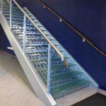Glass Tread Staircase With Stainless Steel Cable and Wood Hand Rails