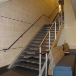 Granite Tread Staircase With Stainless Cable and Wood Hand Rails