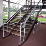 Tile Tread Staircase With Alumnium Rails and Glass Panel Guards