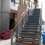 Wood Tread, Laser Cut Steel Risers Staircase with Glass Pannels and Wood Hand Rail
